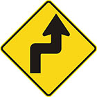 yellow diamond-shaped sign with black arrow that has tail bent at right angles right then left