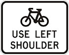 white sign with black icon of a bicycle and the words use left shoulder