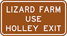 brown sign with white text, lizard farm use Holley exit
