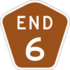 brown pentagonal sign with the text end 6