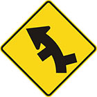 yellow diamond-shaped sign with black arrow that curves steadily left with alternate lines branching off on both sides of the curve