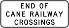 white sign with black text, end of cane railway crossings