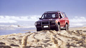 4 wheel-drive vehicle on the beach.