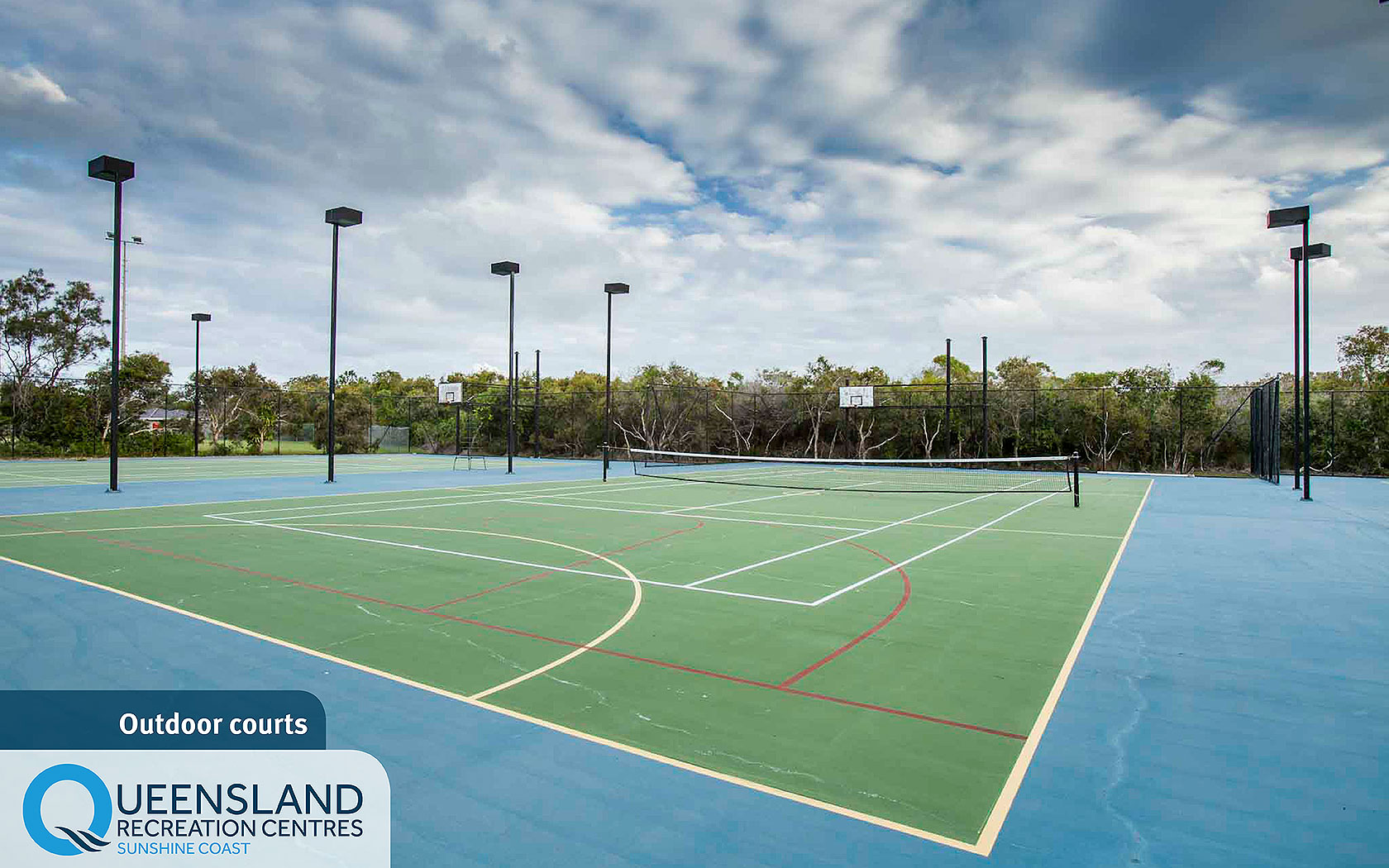 Fence-enclosed outdoor courts set up for tennis at the Sunshine Coast Recreation Centre