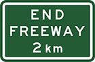 green sign with white text, end freeway 2km