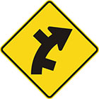 yellow diamond-shaped sign with black arrow that curves steadily right with alternate lines branching off on both sides of the curve