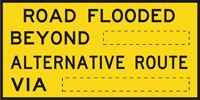 Image of a sign showing that the road ahead is flooded and what the alternative route is
