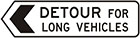 white sign with black arrow and text, detour for long vehicles