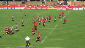 Rugby union game being played on the sports field.