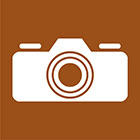 brown sign with a camera icon