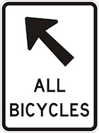 white sign with black arrow and the words all bicycles
