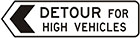 white sign with black arrow and text, detour for high vehicles