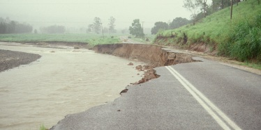 Erosion causing serious damage to a road