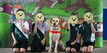 Children with Aka the fire ant tracking dog at a school presentation