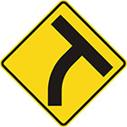 yellow diamond-shaped sign with black T shape which curves to the right at the stem